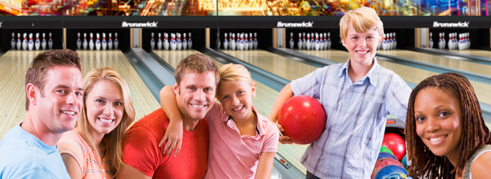 Happy family and friends at bowling alley