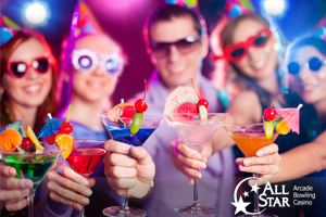 Partygoers holding colorful drinks