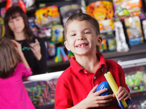 Young boy with arcade redemption center prizes