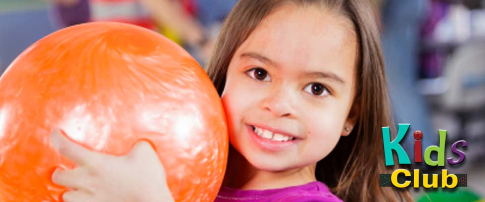 Kids Club - Young girl holding a bowling ball