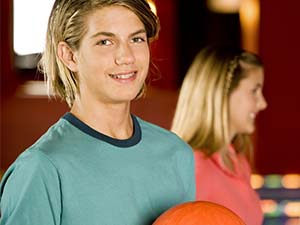 Smiling Teen Holding a Bowling Ball