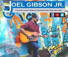 Joel Gibson Jr. playing guitar leaning on graffiti wall